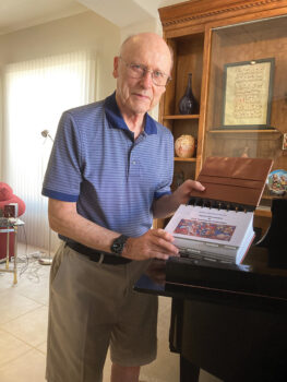 Chuck Aurand with the inventory catalogue of his recent musical instrument donation to Michigan State University (Photo by Sue Case)