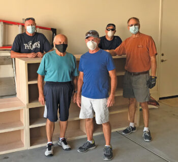 SaddleBrooke Ranch woodworkers (left to right): Ron Gustafson, Jeff Hansen, Barry Milner, Scott Saxson, and Dan Carter made bookcases for first grade students in Kearny.