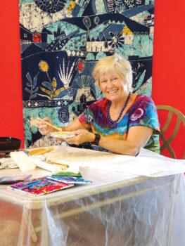 Greta von Wrangel carefully applies wax in a detailed pattern as she creates a batik design. (Photo by LaVerne Kyriss)