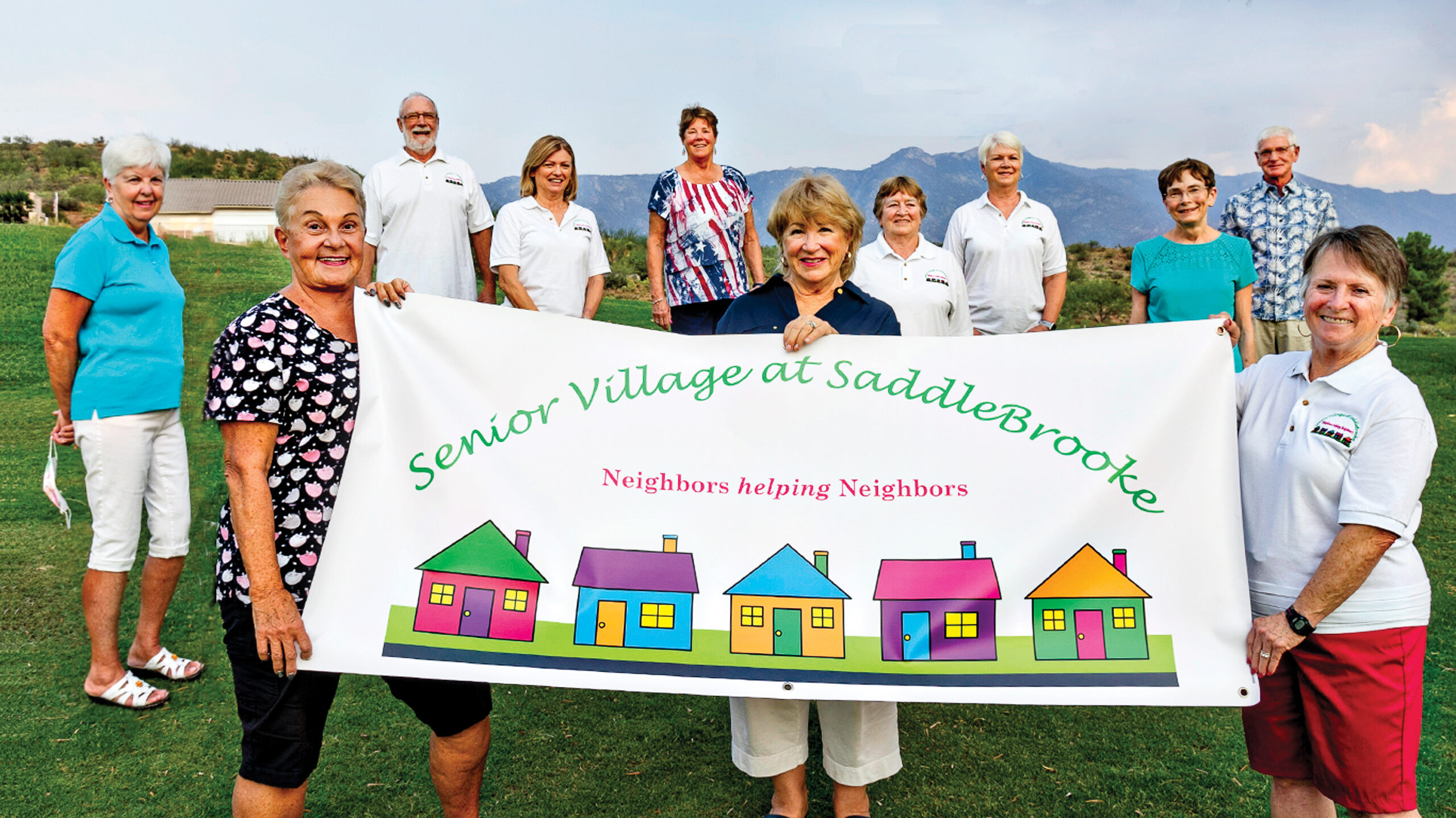 Volunteer team leaders enthusiastically celebrate the fifth anniversary of Senior Village.