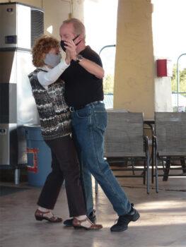 Wanda Ross, SBDC Secretary, and Bob Osborne dance a tango.