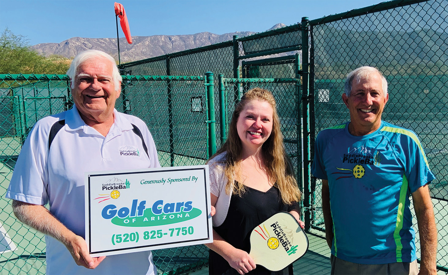SPA co-chair of the fundraising committee, Jim Schlote; Golf Cars of Arizona Service Manager, Allison Honeycutt; SPA President, Peter Giljohann