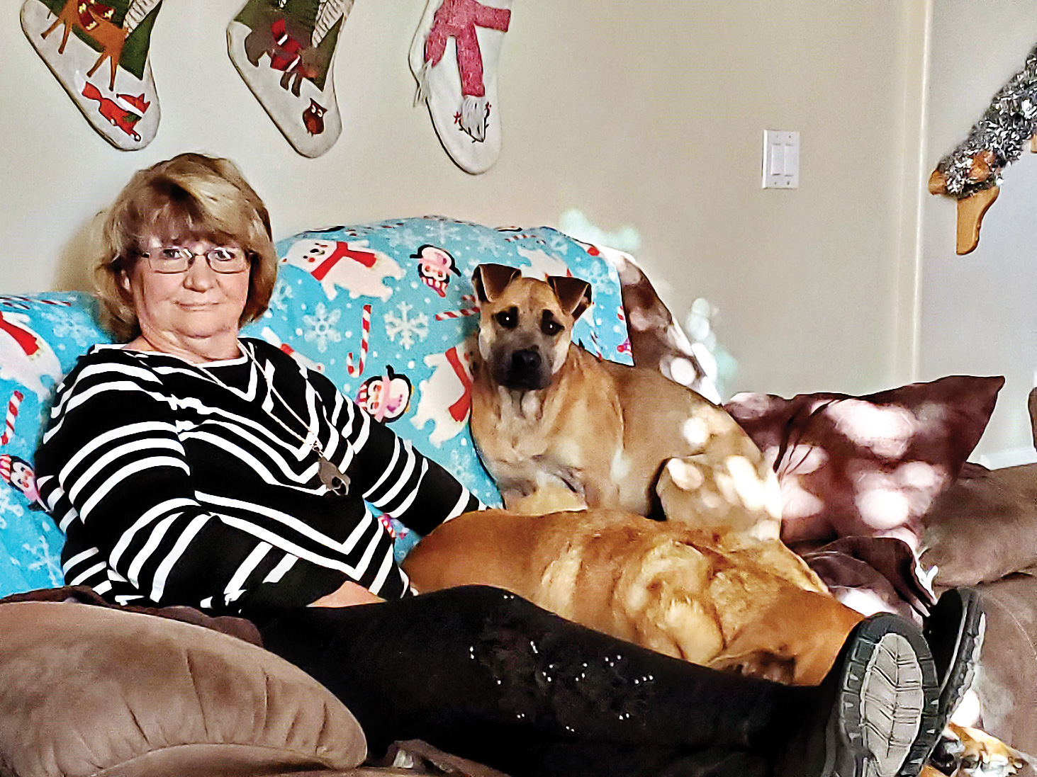 Eileen Depka babysitting grand dogs (Photo by Jeff Depka)