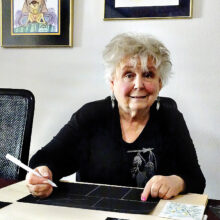 Leslie Farber works on creating hand-painted Christmas cards for family and close friends. (Photo by LaVerne Kyriss)