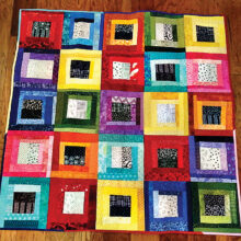 Scrap quilt Kris made to play with color against black and white patterns.