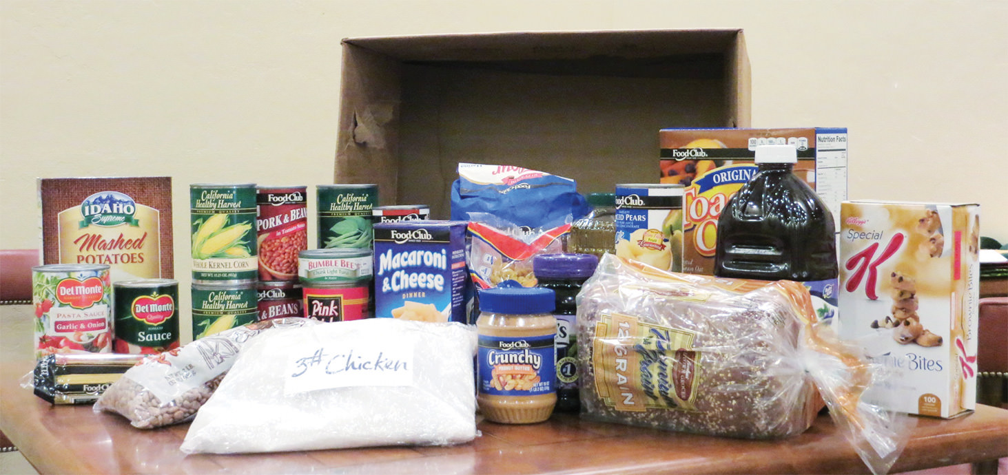 An emergency food box from Tri-Community Food Bank provides the ingredients for nine family meals.