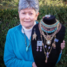 Dorothy displaying samples of her handcrafted jewelry (Photo by Russell C. Stokes)