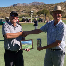 Lee Leksell (left) is congratulated by Dan Nordhill, MPMGA president, on winning the 2020 President's Cup.