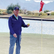 """""""Look what I found."""" Gordon Elliott on hole number 8 at MountainView, after scoring a hole-in-one."""