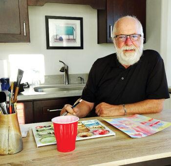 Carl Saulsbury sits in his casita studio. (Photo by LaVerne Kyriss)