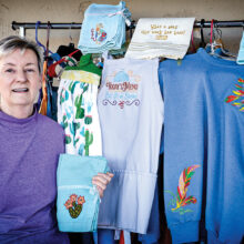 Kathy presenting some of her embroidery creations (Photo by Russell C. Stokes)
