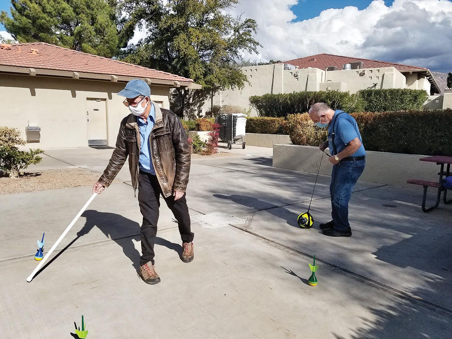 Hans Von Michaelis practicing reach and Ted Birchard practicing kicking while walking.