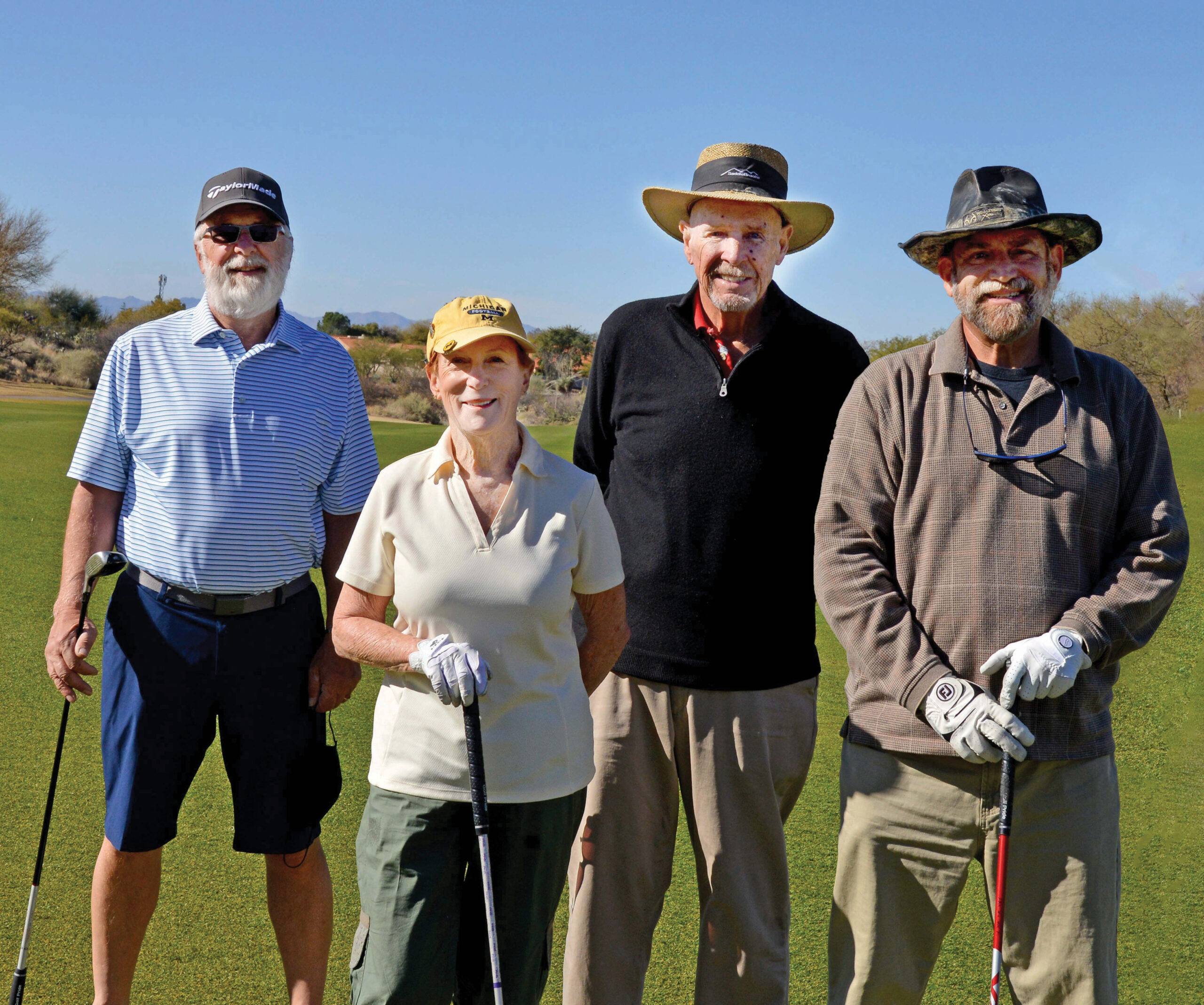 Winners: John Thomas, Marsha Foresman, Calvin Saulsbury, and Bob Nelson