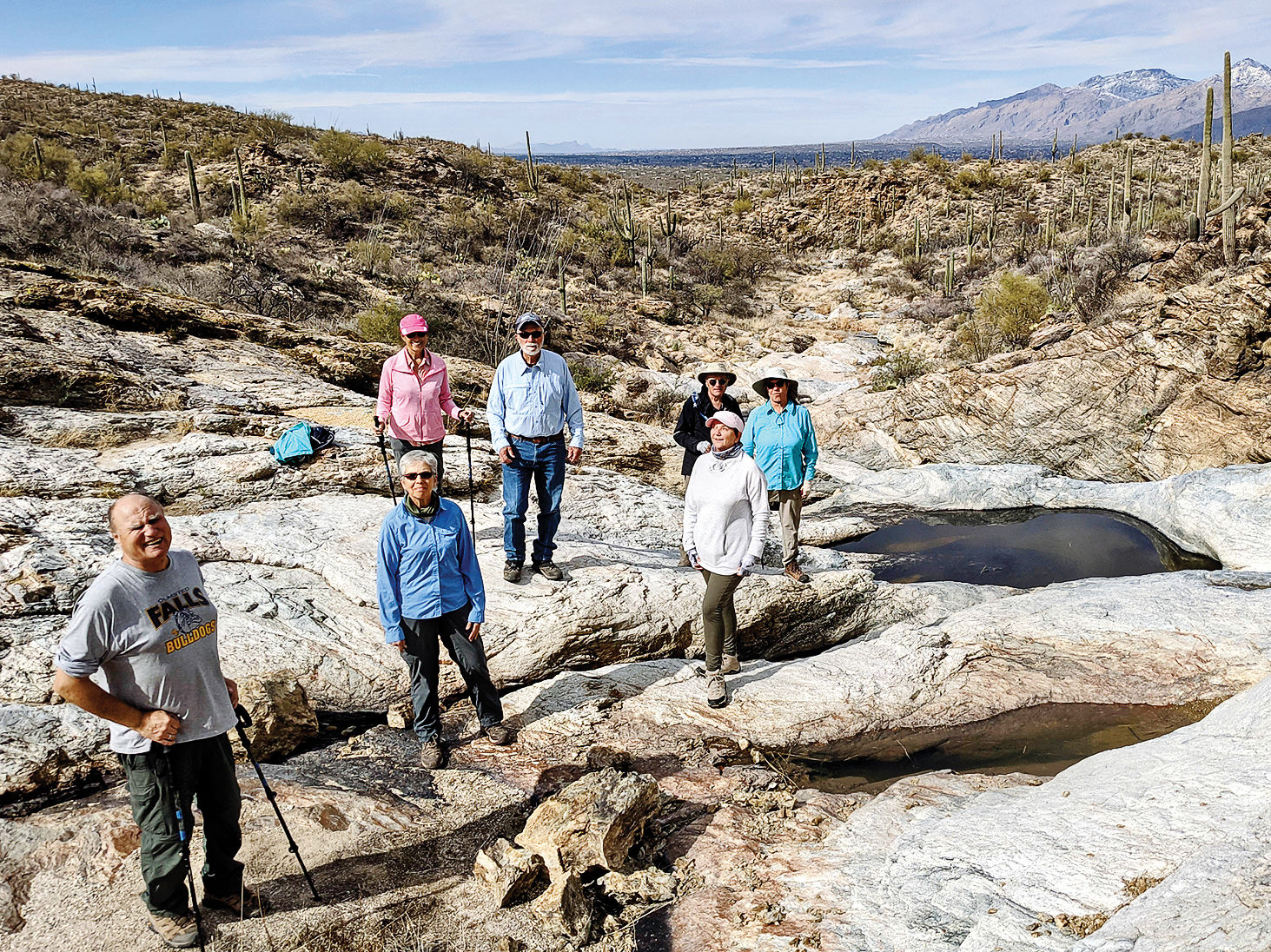Hikers pause by Little Horse Tank pools. (Photo by Ruth Caldwell)