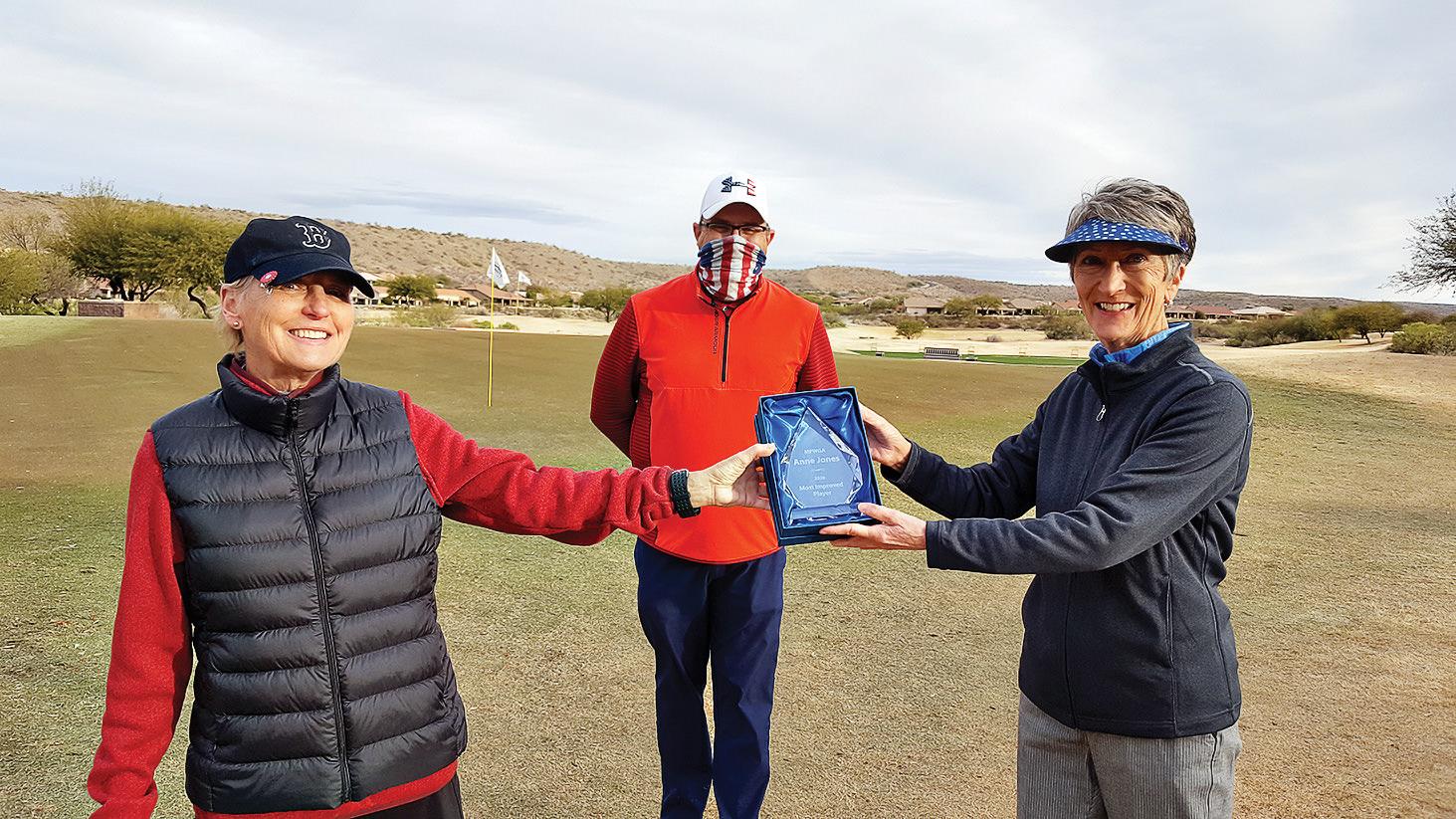 Debbie McMullin, Mike Karpe, and MIP recipient Anne Jones, smiling as bright as her crystal trophy. (Photo by Ann Van Sickel)