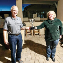 Last year's champ, Gayle Heaton, awards Dennis the 2020 trophy.