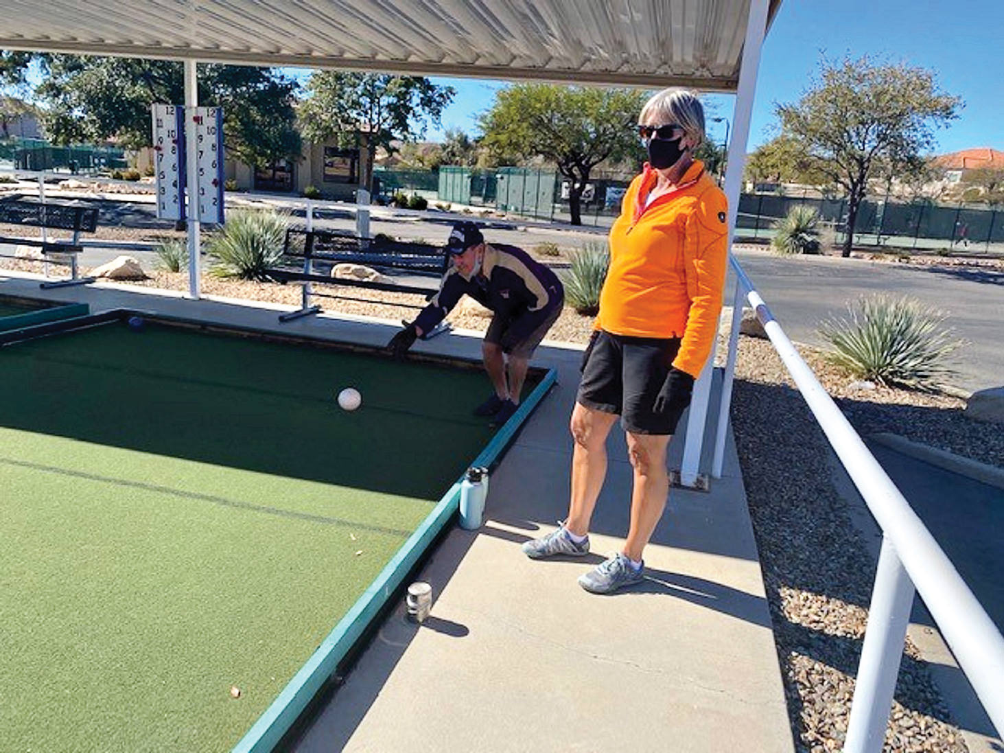 New neighbors, Janet and Doug Drake, try some bocce ball (Photo by by Fira Stout)