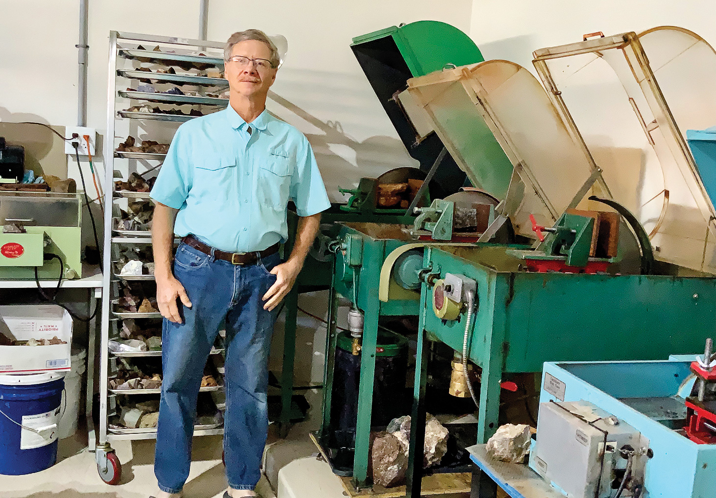 Dave Lancaster in his garage with rock saws (Photo by Judy Lancaster)