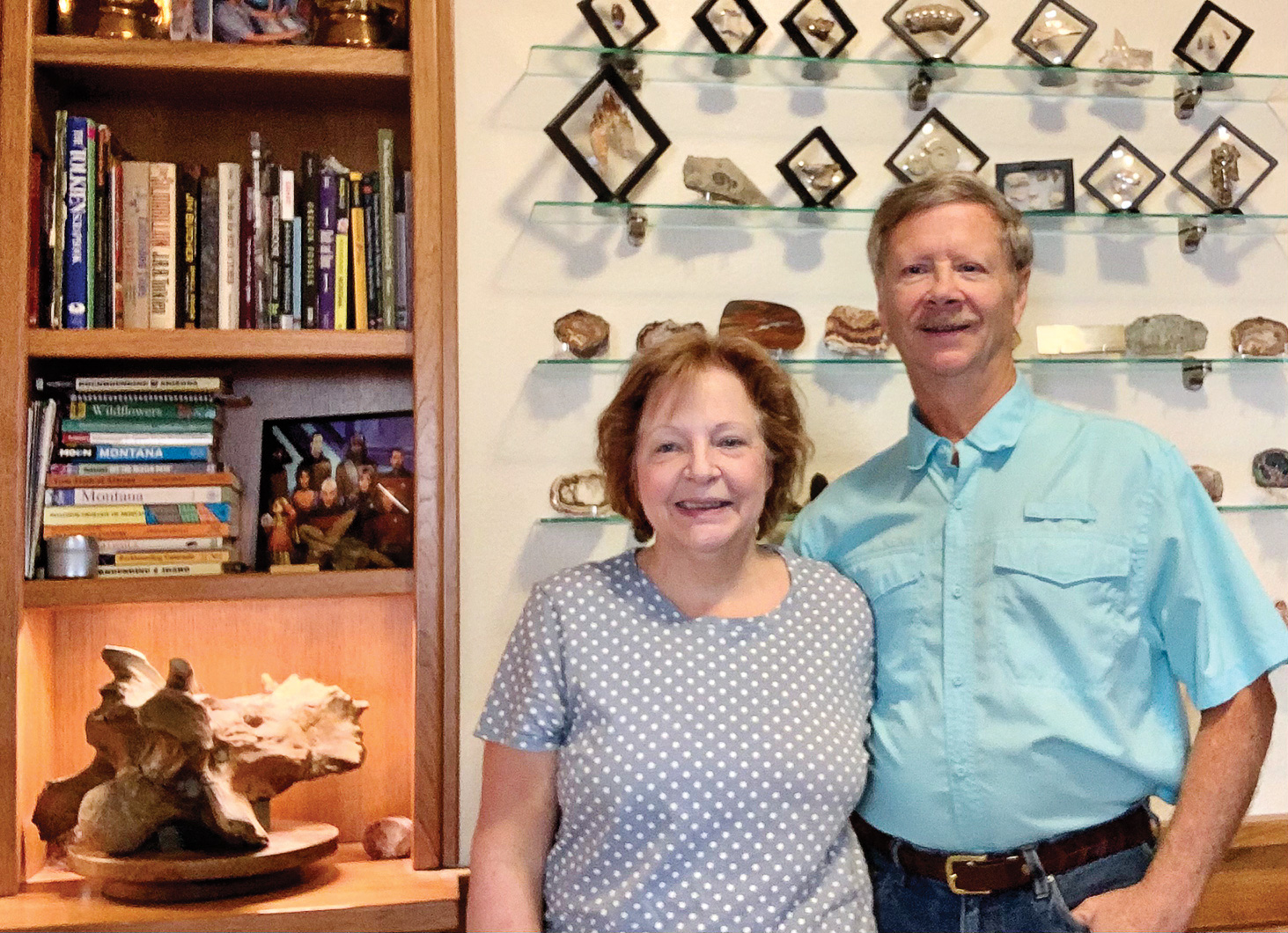 Judy and Dave Lancaster at home with their triceratops fossil find (Photo by Judy Lancaster)