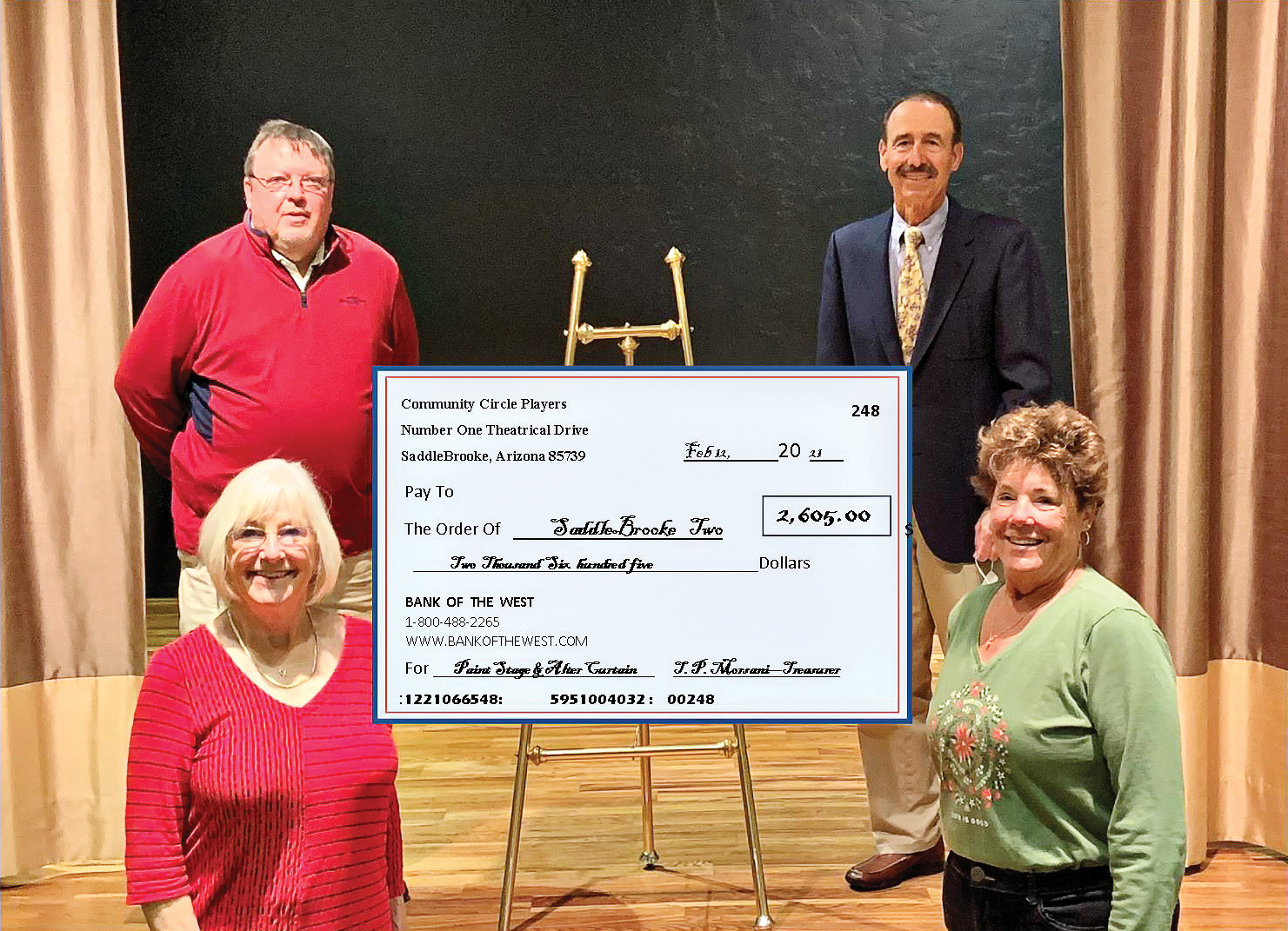 SaddleBrooke TWO Executive Director Damon Williams accepting a check from CCP's CFO Tim Morsani and CCP co-founders Shawne Cryderman and Susan Sterling.