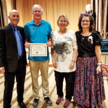 Steve and LuAnn Johnson (center) getting their square dance graduation certificate from J.P. Blount (left) and Cindy Blount (right)