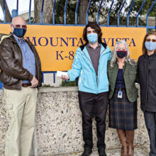Mark Erickson and Marcia Schima donating check to Mt. Vista School.