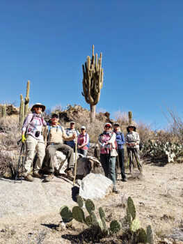 Hikers pose in front of a great saguaro (Photo by Tim Butler)