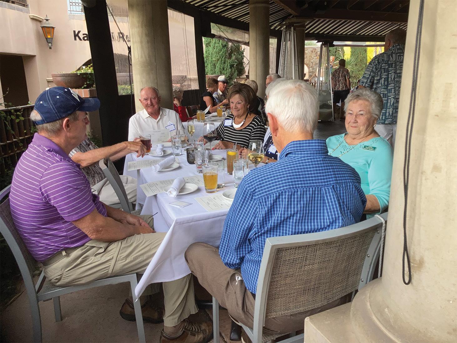 Residents enjoying a Dine Around dinner on the patio at Tavolino Ristorante Italiano.
