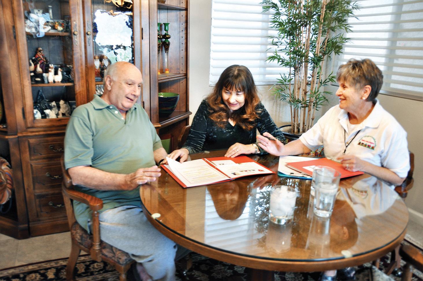 Vicki and Nick Palumbo meet with membership volunteer, LaVonne Ashwood, to join Senior Village.