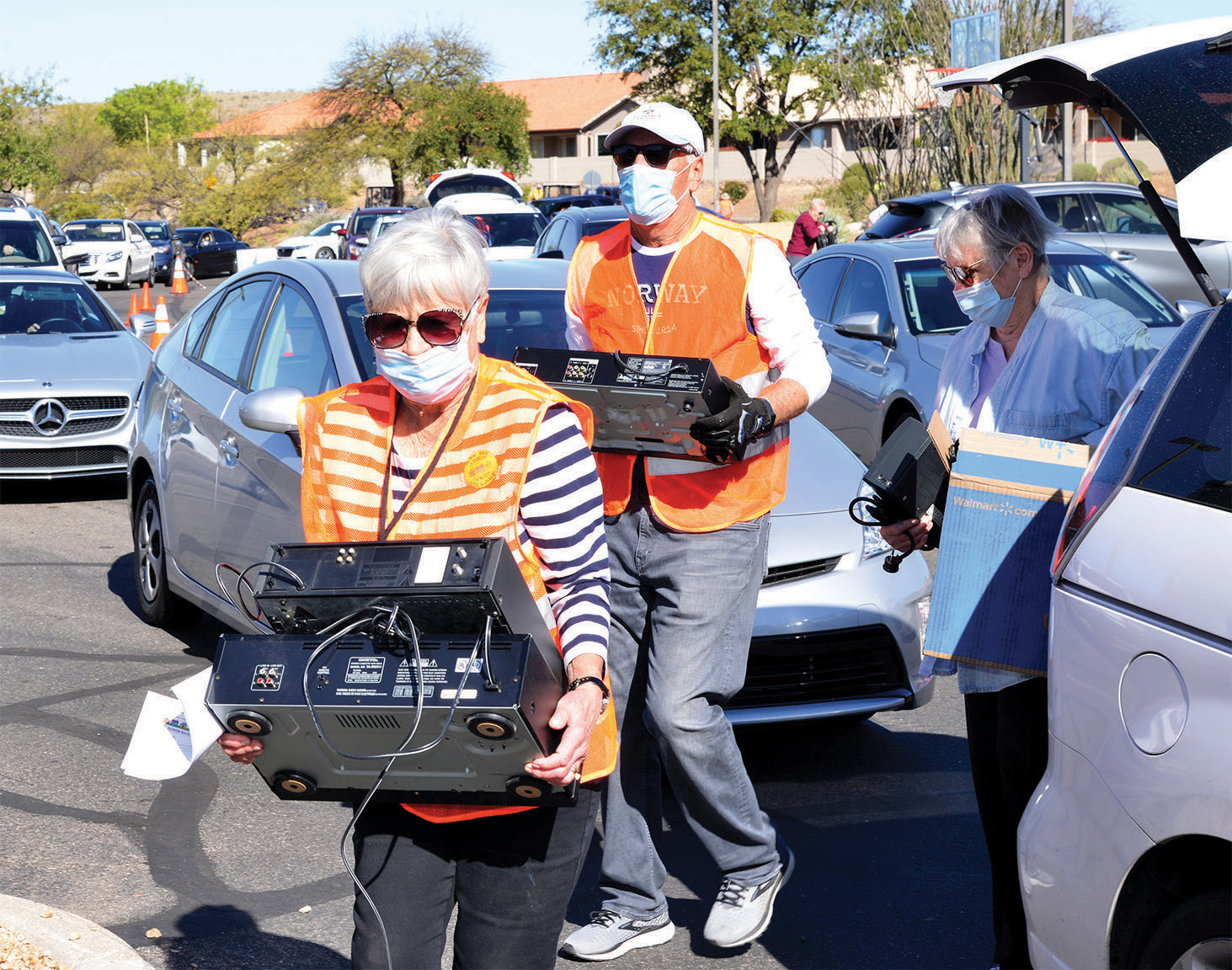 Senior Village volunteers unload electronics for recycling.