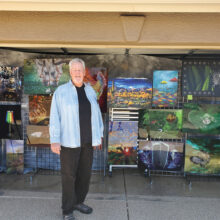 The picture of Jay standing in front of his art suggests he has been doing this for many years.