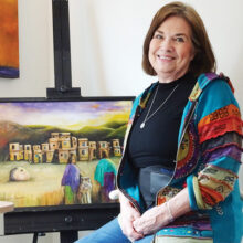 Suzanne Brubaker pauses in her studio with an in-progress work. (Photo by LaVerne Kyriss)