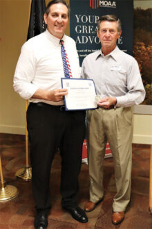 Colonel Nagy presents the Certificate of Appreciation and MOAA Challenge Coin to Douglas Harpold.