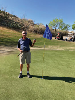 Mark Kunnen with his ball that found the cup on number 6 at the Preserve.