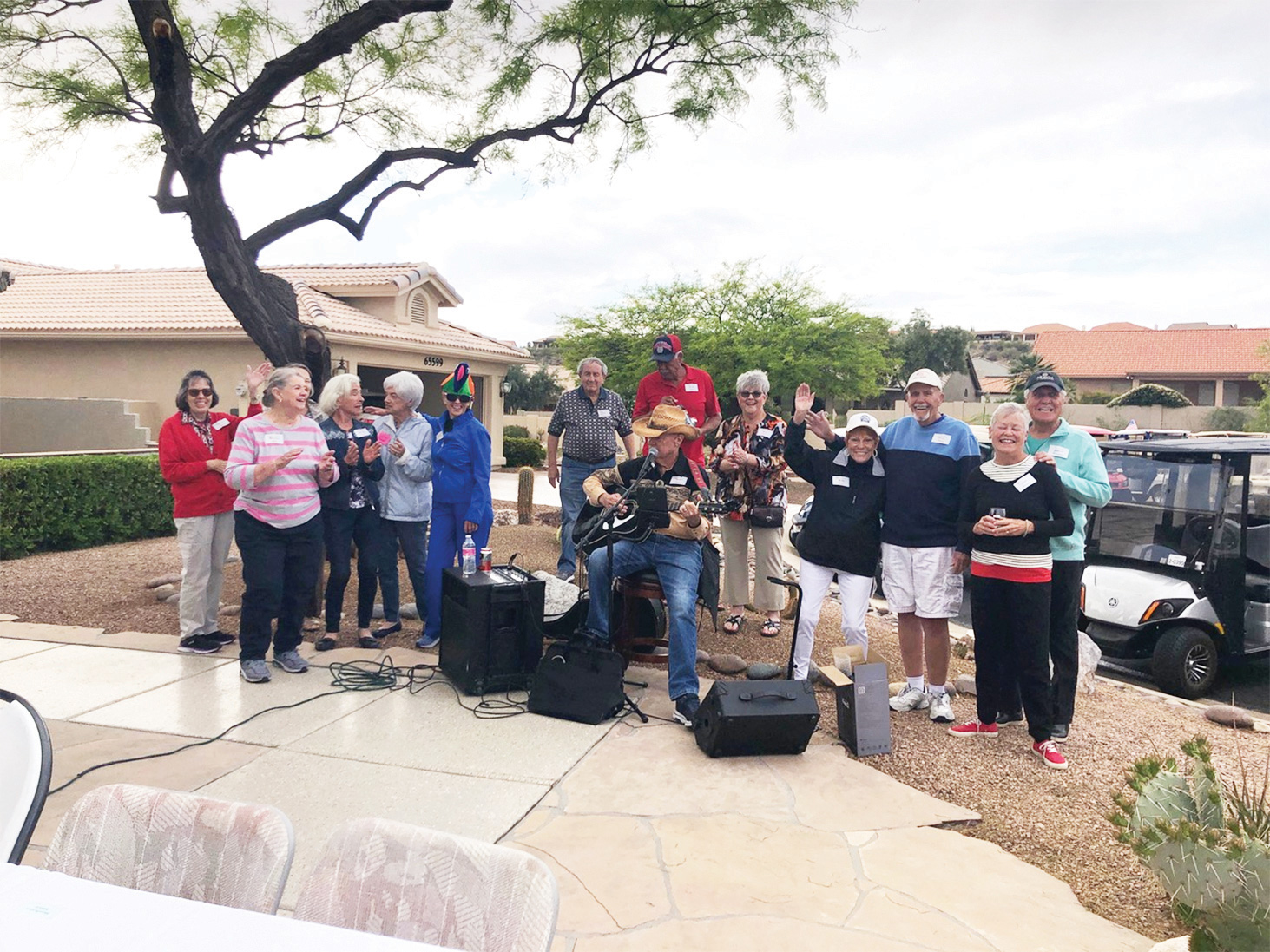 Ninety-nine residents of Unit 17 gathered in two driveways to partake of homemade chili, slaw, cornbread, and cookies from the Stoney Flower Bakers.