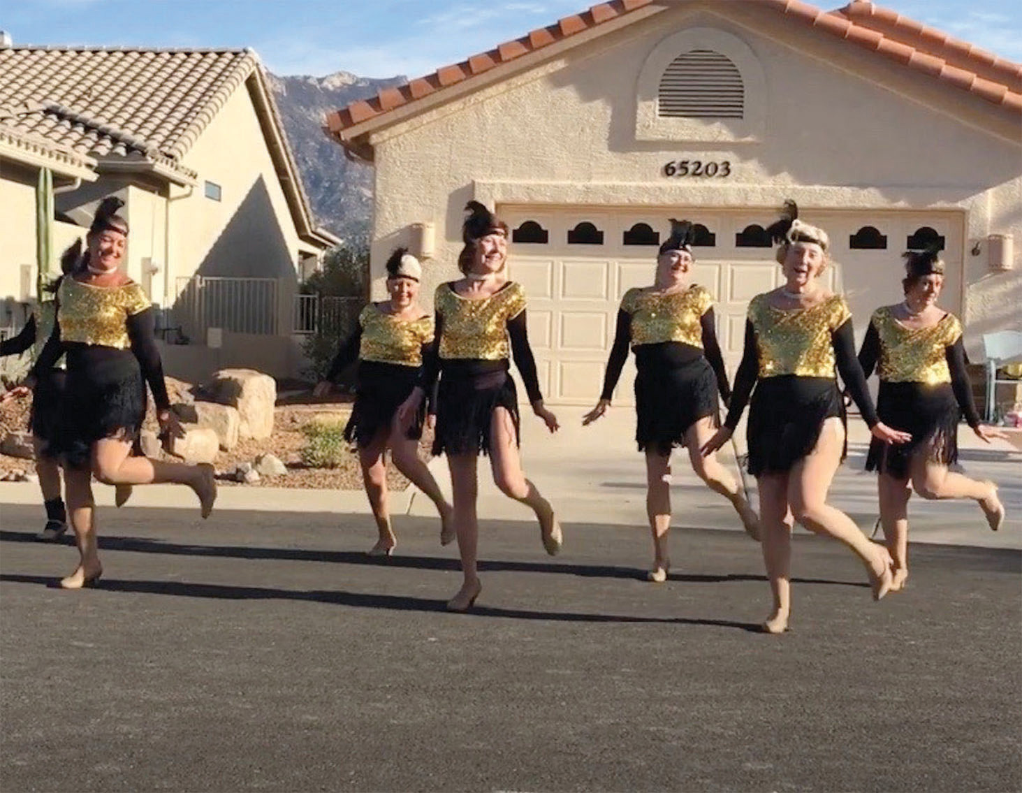 """The SilverBelles danced on Diamond Ridge cul-de-sac for a very enthusiastic audience in Unit 10. This was the debut for their new dance to """"Hot Honey Rag."""""""